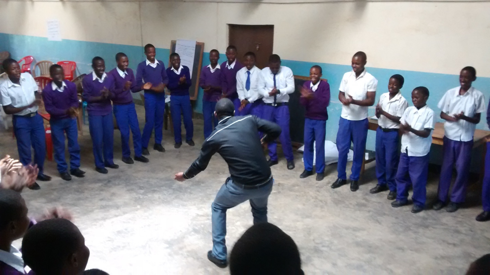 My co-facilitator Michael Mwaigombe leading the participants into an energizer in order to give our day a right rhythm.