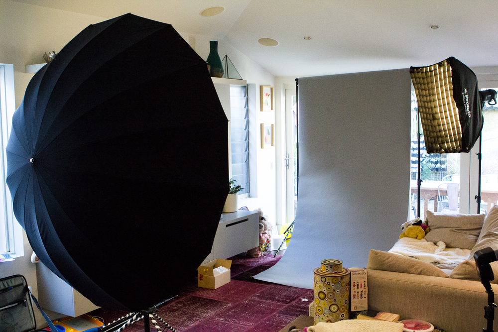 Client's lounge room. This is our 7 foot parabolic umbrella in action. It creates an amazingly soft wraparound light. We used this setup to get some 3/4 body shots.