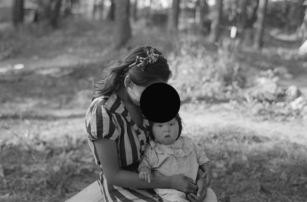 Young Indian mother and baby, blueberry camp, near Little Fork, Minnesota. August, 1937.