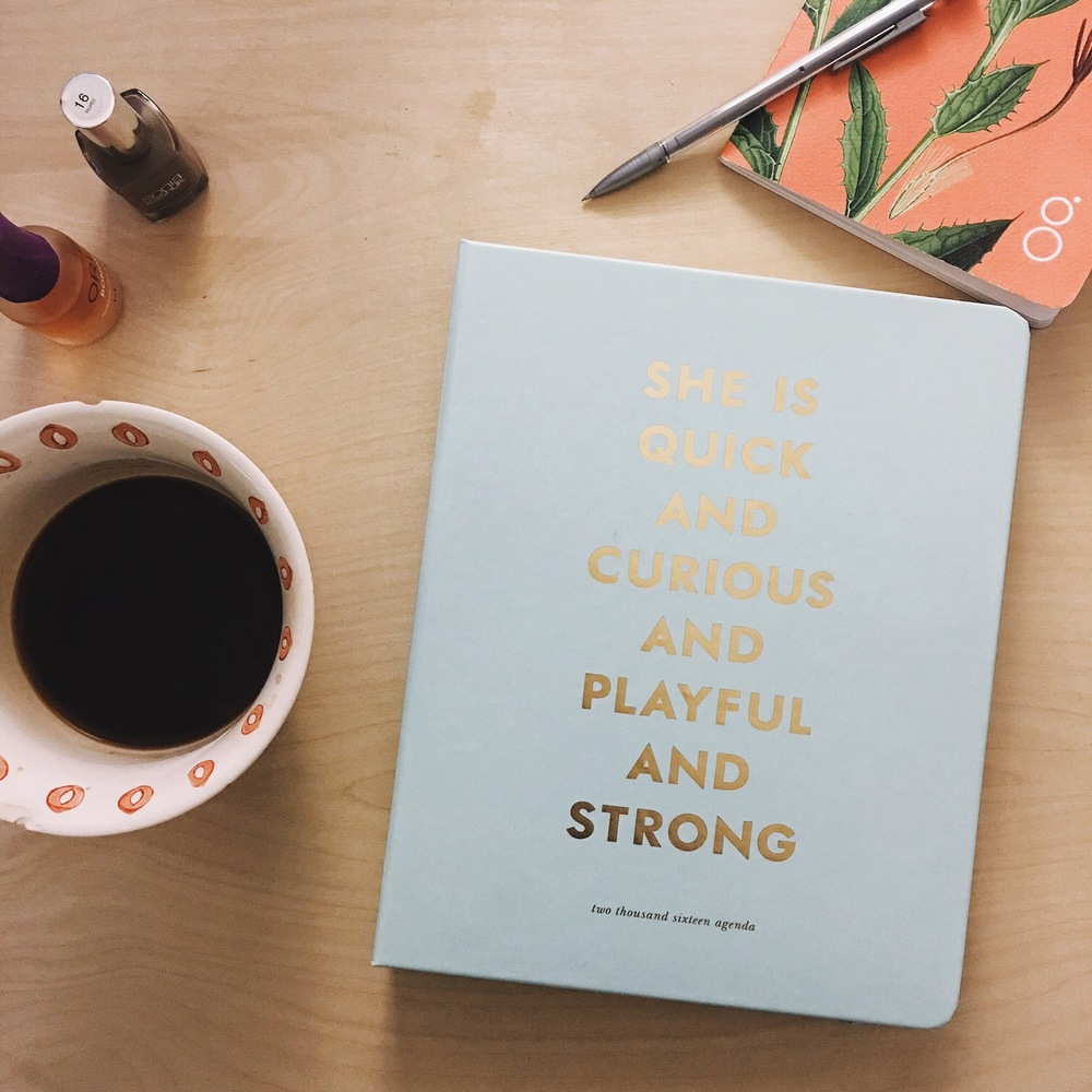 Coffee, day planner, and notebook are essentials!
