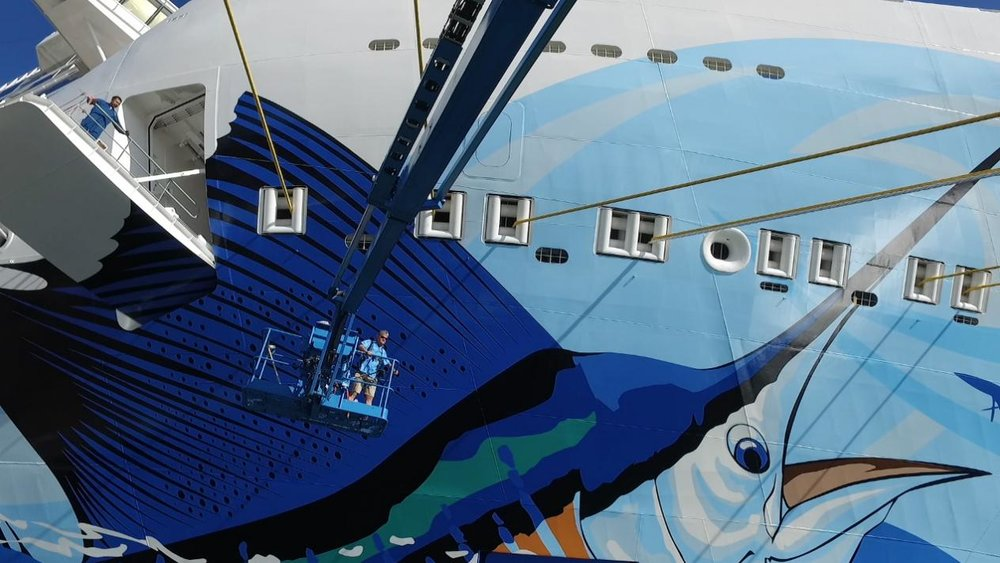 ShermansCruise: Guy Harvey Talks About His Biggest Canvas on  Norwegian Escape     MIAMI — Passengers and passersby can't miss the brightly colored, massive sailfish when they happen upon  Norwegian Escape.  At 1,098 feet, the expansive canvas of Norwegian Escape is the largest ever for famed Marine Painter and Conservationist Guy Harvey.