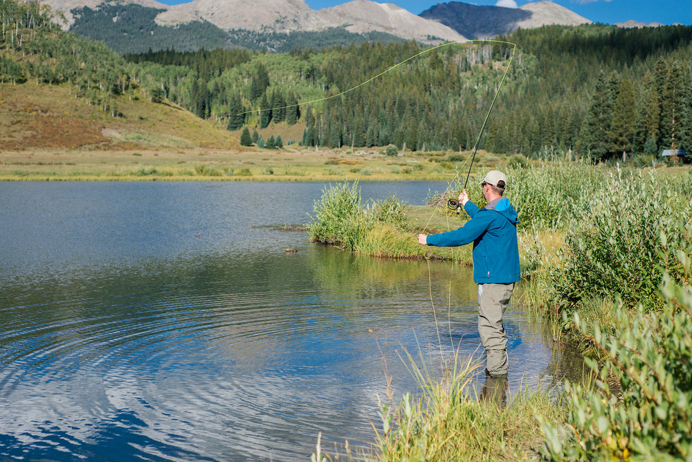 Fly Fishing In Mountain Pond