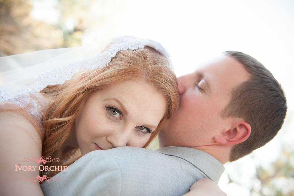 bride peeking over groom's shoulder