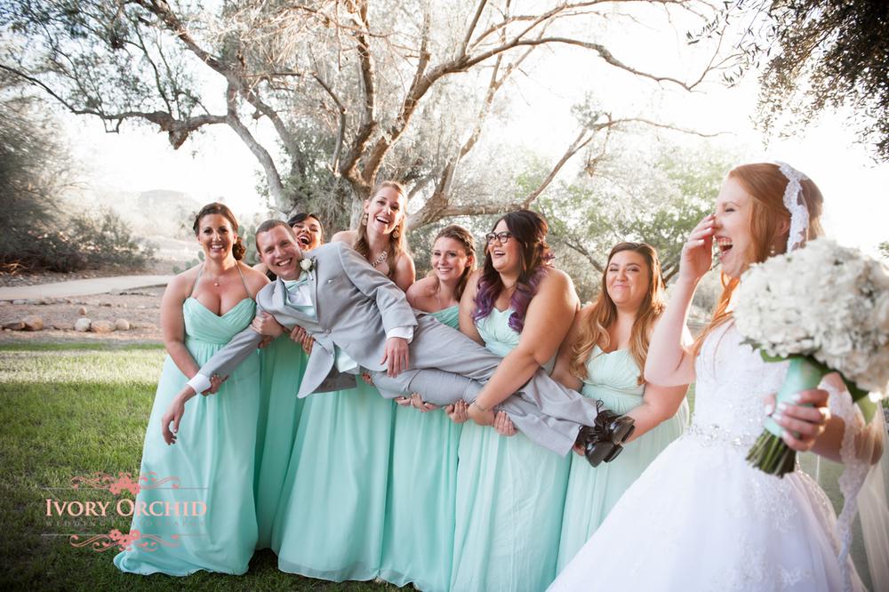 bridesmaids picking up groom