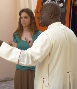 Dr. Gabriella Nanci and Msgr Simon Assamoah loading a van with medical supplies.