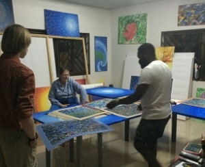 "Yonkofa Project volunteers visiting Ghanaian artist ""Fishman"" Kobina Nyarko, who is internationally renown for his mesmerizing paintings, and was recently featured on CNN as one of Ghana's most prominent artists. His work will be available at our Sept. 13th event."