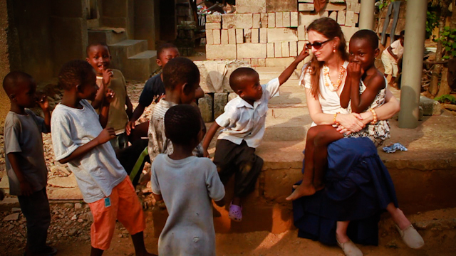 Dr. Gabriella Nanci with children during a malaria screening campaign