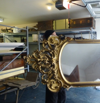 A large Victorian mirror arrives at the new storage location.