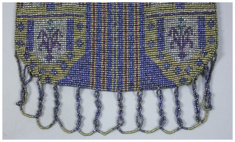 A close up of beaded fringe.