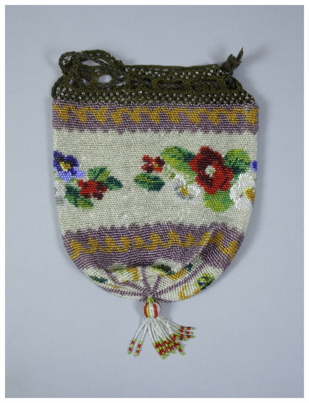 A beaded purse with a floral pattern. There is a brown crocheted edging along the top of the back to attach a drawstring. The drawstring is a brown cord. The beads appear to be attached by a netting technique. There is a beaded tassel at the bottom of the purse.