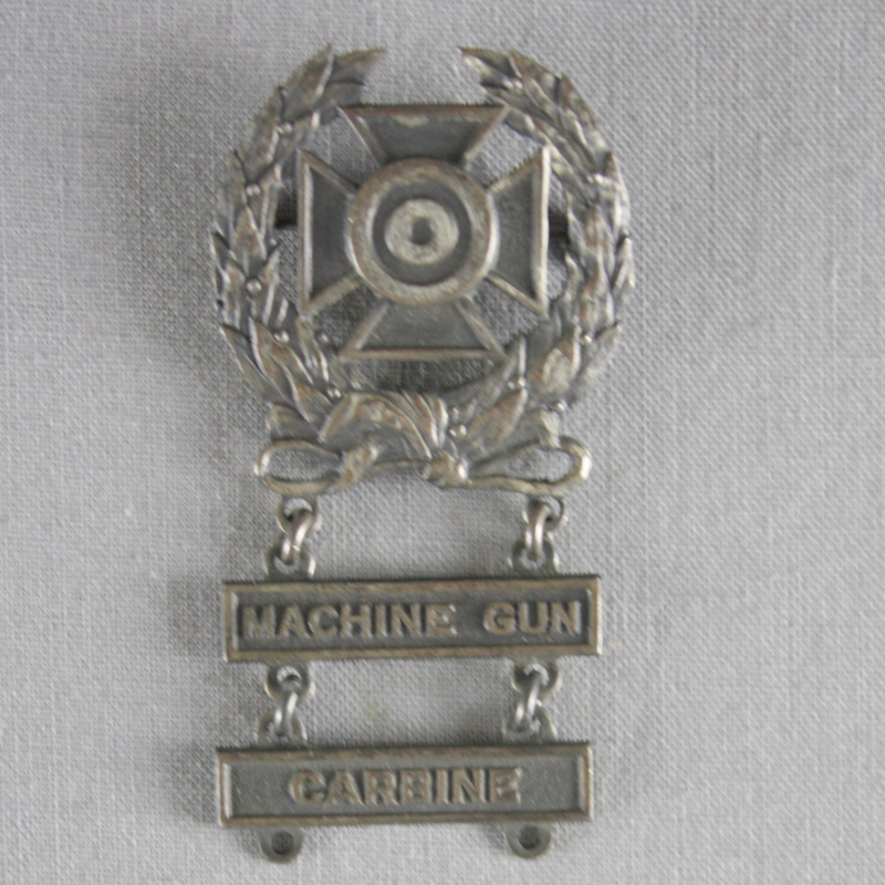 Marksmanship badge- Machine Gun, Carbine.