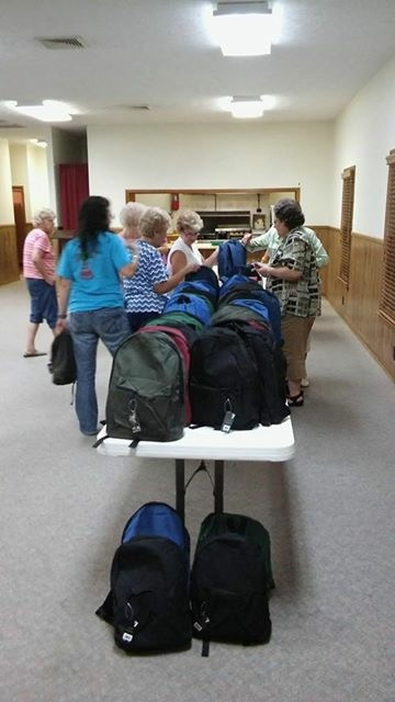 WOM putting together backpacks for Appalachia.