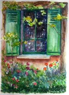I painted one of the windows in Monets house and he painted his house too!