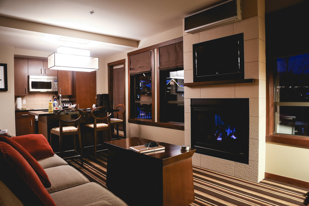 EVOLUTION WHISTLER - EVOLUTION WHISTLERStaying on trend with renting the hotels that I wish were my houses, I ended up staying at Evolution Whistler in the Creekside Village.This one bedroom apartment offered a king size bed, cute bathroom, cozy living room + fireplace, a huge balcony, amazing kitchen and in-suite laundry. To top it off, it's slope side WITH THE MOST INCREDIBLE YEAR ROUND POOL. Sorry for shouting, there's just something so magical about swimming in a heated pool while giant snowflakes fall onto your face. And don't get me started on the eucalyptus steam room...Constantly rated in the top 10 hotels in Whistler, the property offers one, two and three bedroom apartments with full access to all amenities. For all those with doggos - this spot is pet friendly. Check it out.