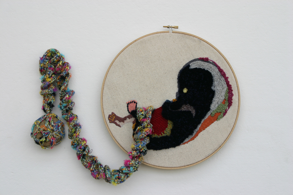 Fetus Embroidery on canvas, crochet, stone. Variable size. 2011
