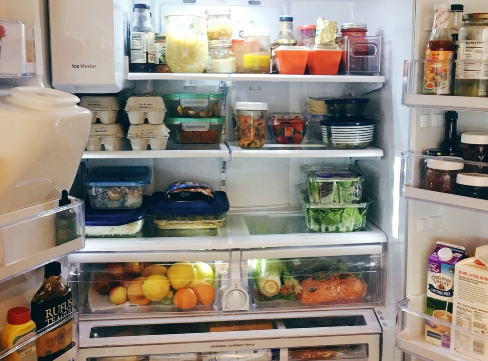 This picture of our fridge was from before starting the diet, but apart from the dairy and peppers and fruit it doesn't look that different today. I usually put sauces and kraut on the top shelf, eggs and leftovers on the middle, and veggies on the bottom shelf and drawers. We keep dairy and meat in the bottom pull-out drawer.