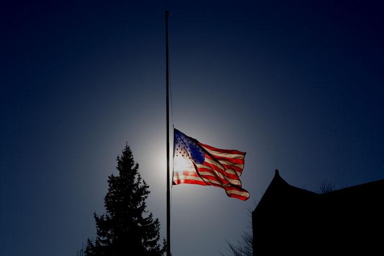 US flag flying at half staff