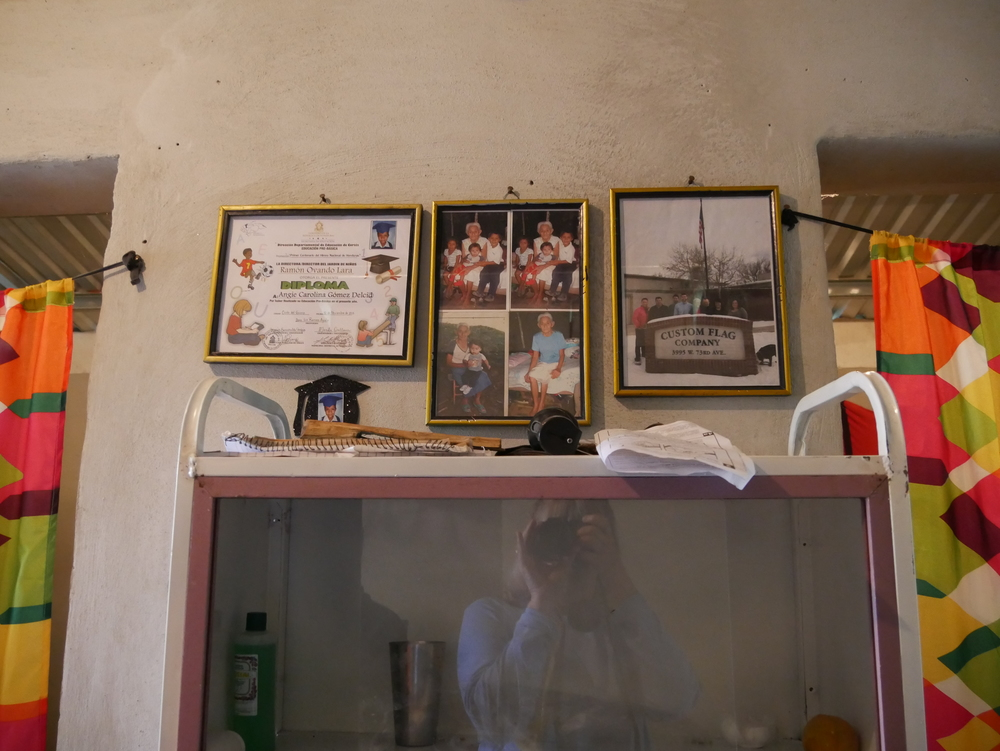 Framed photo (right) of the CFC team hanging in Honduras home.