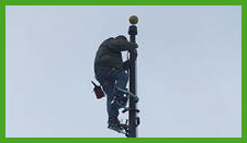 Steeplejack on flagpole