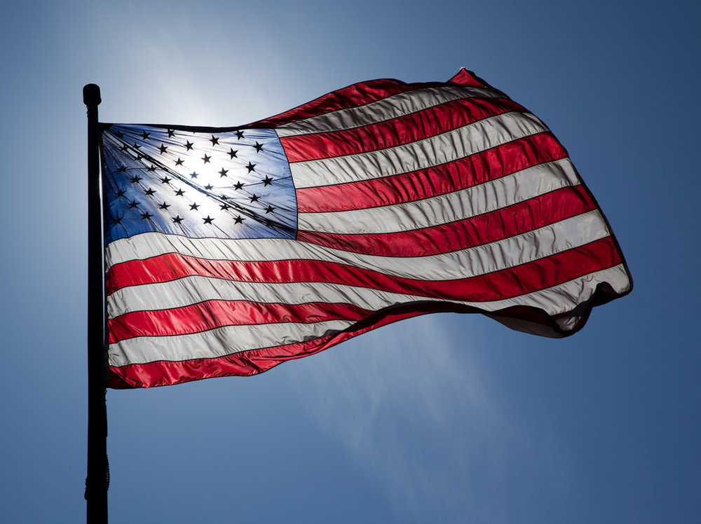A nylon flag with the sun gleaming through.
