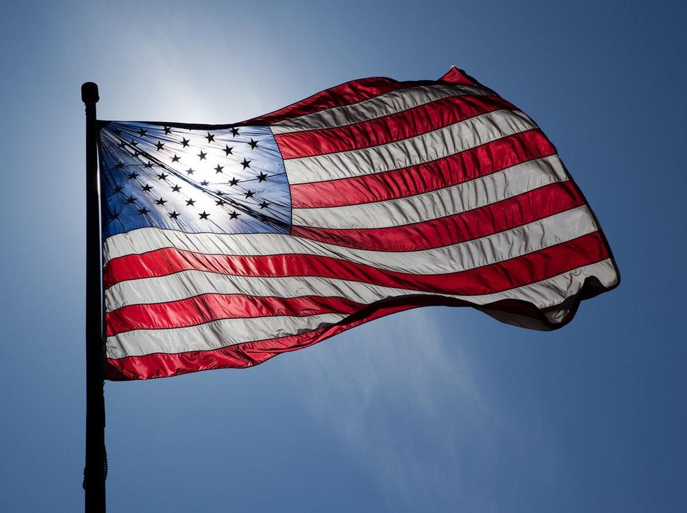 A nylon flag with the sun gleaming through.