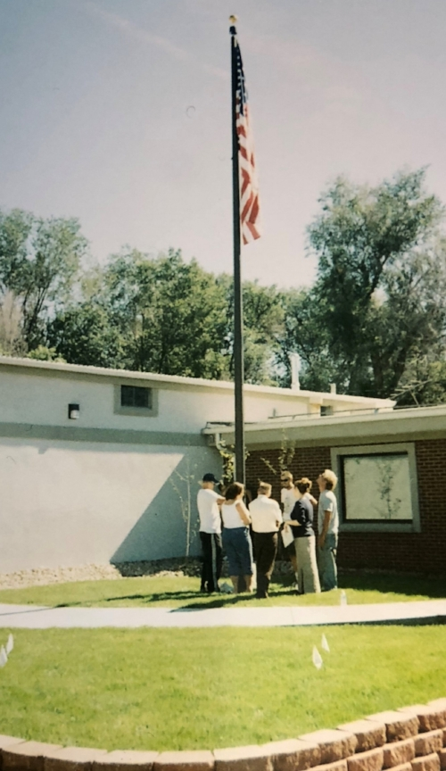 2004: Installing flagpole @ CFC. Our sign had not been installed. Look at the size of the aspen trees behind the flagpole.