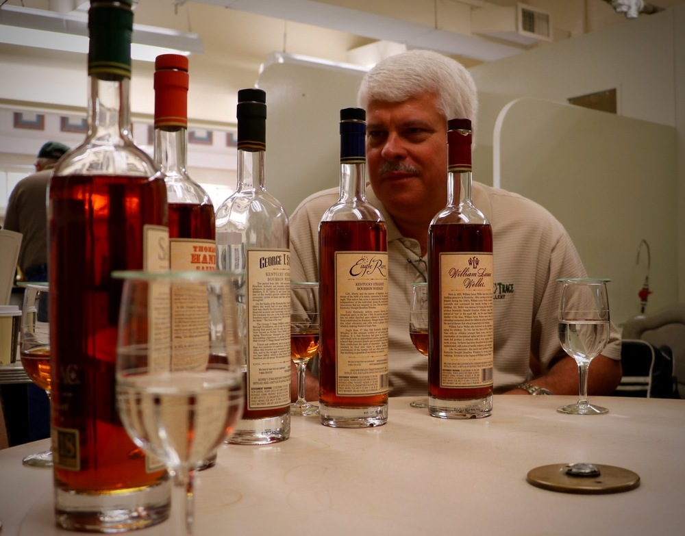 Drew Mayville, Sazerac Master Blender, sits behind the 2015 BTAC Line. Photo credit: Glenford Jameson