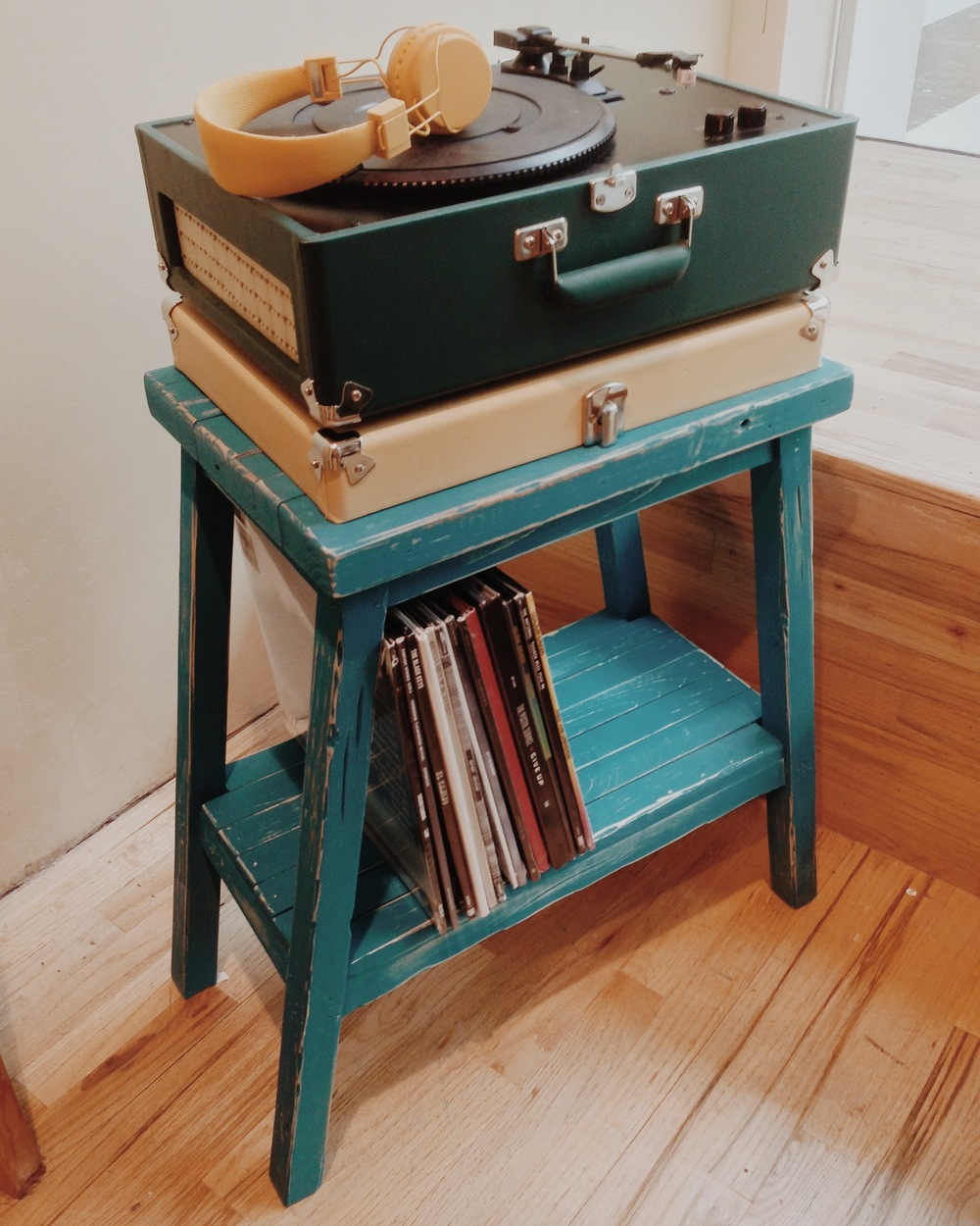 Aged record player stand created from scrap materials