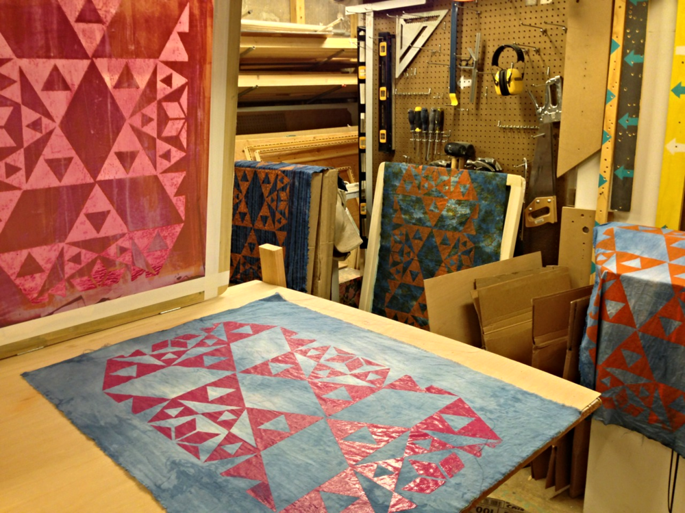 Screen printing geometric designs for wallpapered fabric