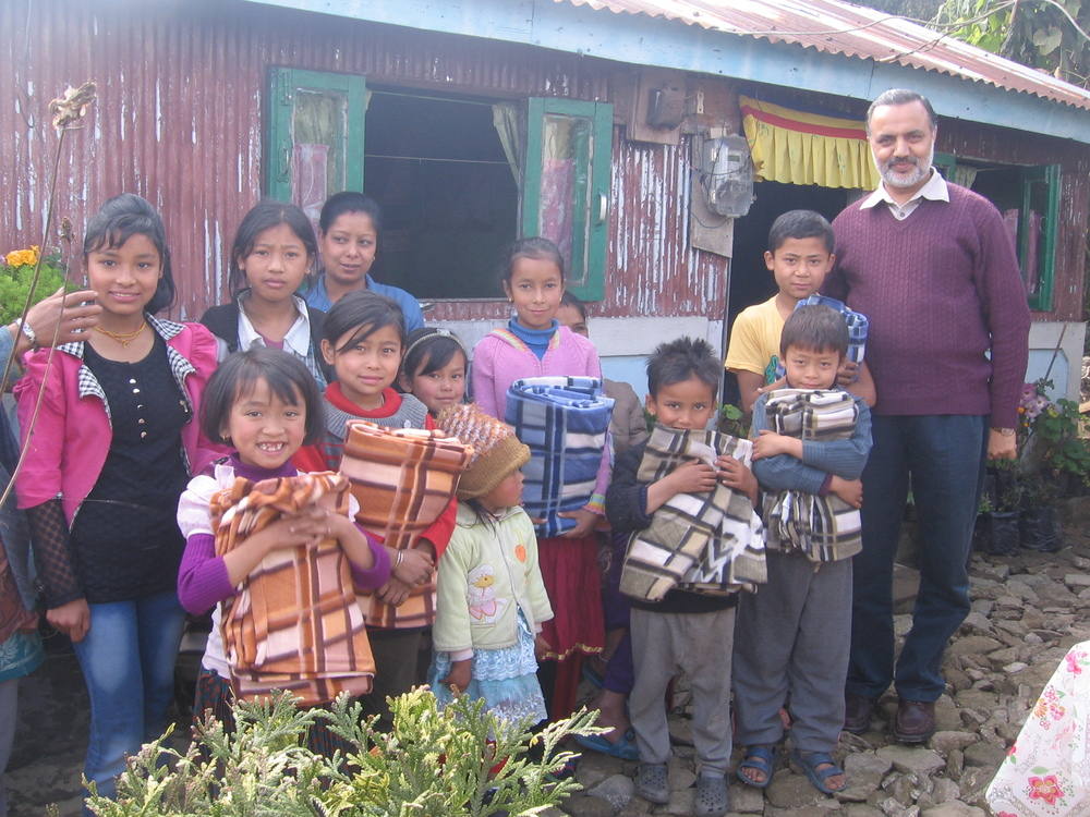 Kiran Sharma (right) with some happy children after they received their new blankets