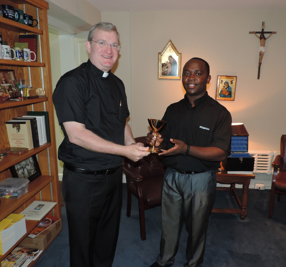 Rev. Patrick L. Posey (L), Diocesan Director of the Society for Propagation of the Faith for the Diocese of Arlington, VA presents a chalice donated by the Knights of Columbus Fr. Robert O. Hickman Assembly #1883 to Rev. Ghenghan Mbinkar of Cameroon.