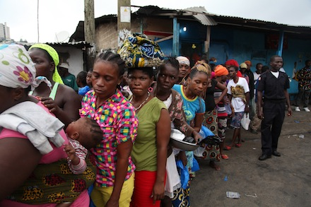 Liberian residents of West Point wait for food rations to be handed out in Monrovia, Liberia (Photo copyright CNS)