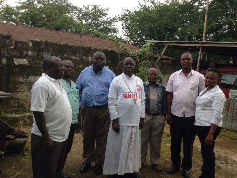 Archbishop of Freetown Edward Tamba Charles with aid workers in Sierra Leone.
