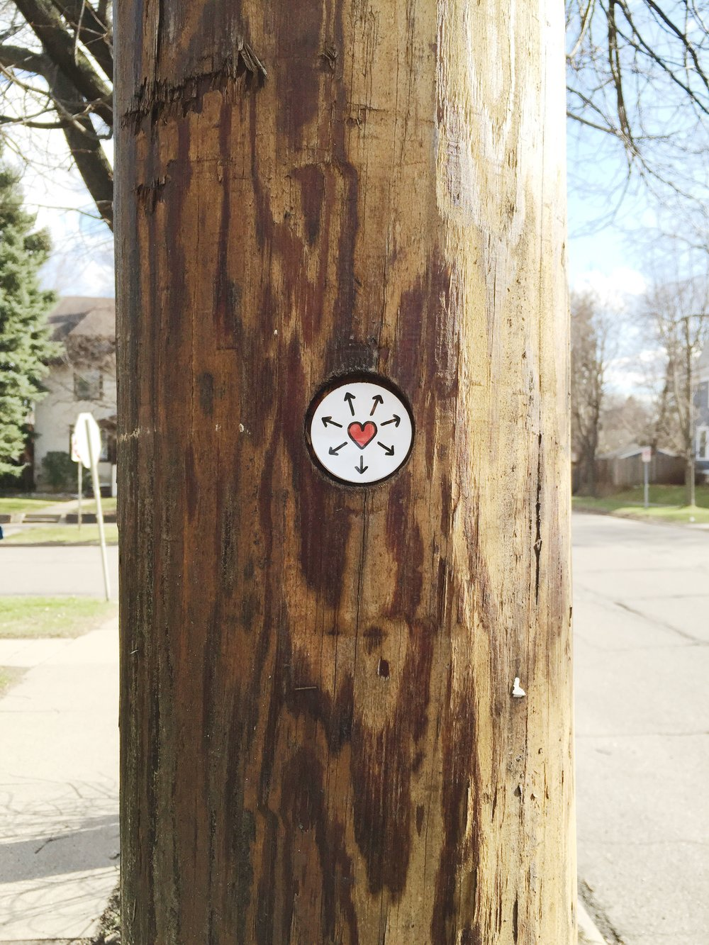 ian-valor-spread-love-symbol-telephone-pole.jpg
