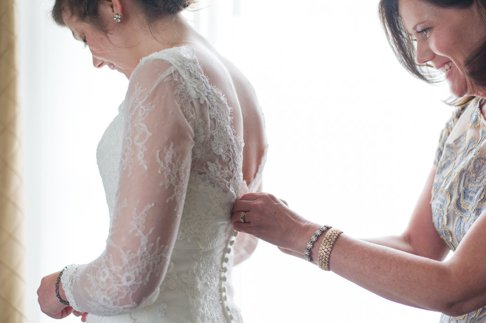 white wedding dress final touches bride and mother