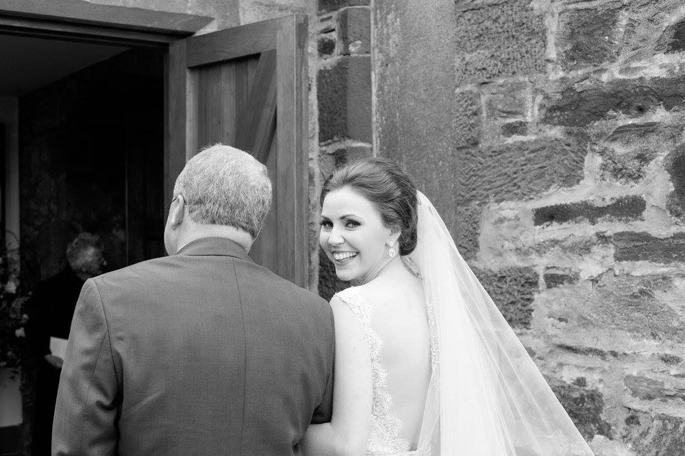 Destination wedding father daughter down the aisle