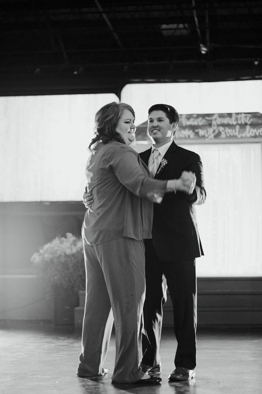 Ansley Wedding-first dance cake cutting-0092.jpg