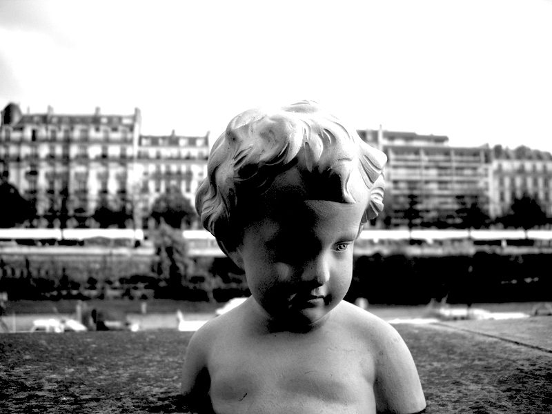 This is a picture I took of a small sculpture at a Brocante in Paris.  The Seine is in the background.