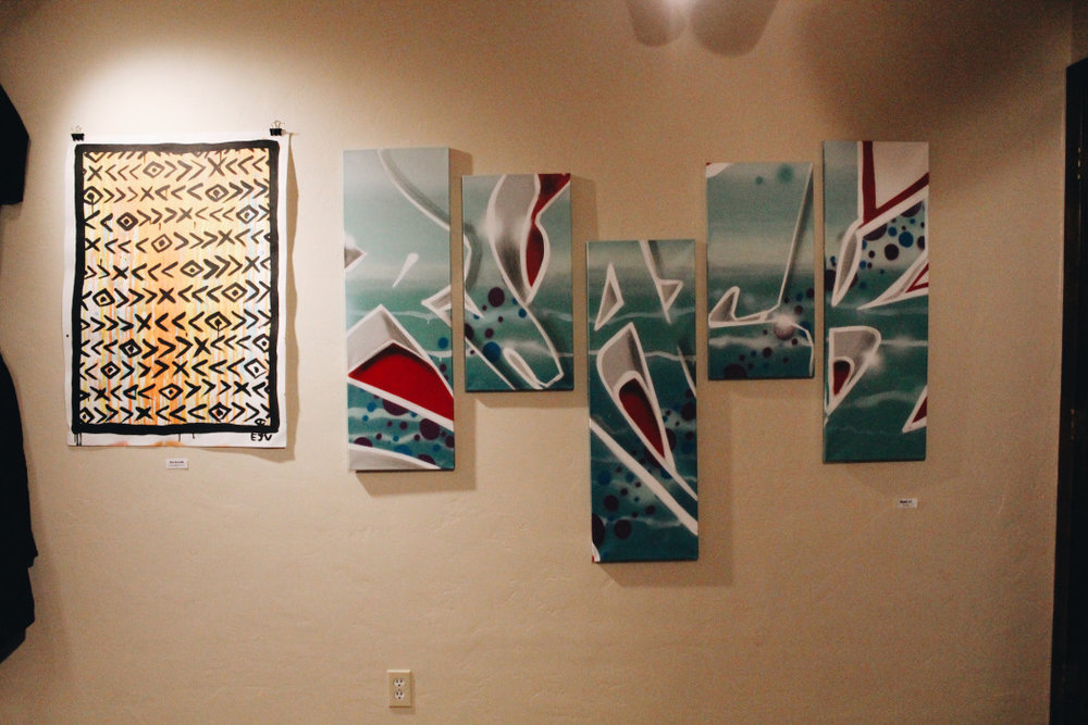 Pictured on the left: painting on paper by Eric Vozzola, Pictured on the right: multi-canvas painting by Black57  Photo: Victoria Fong