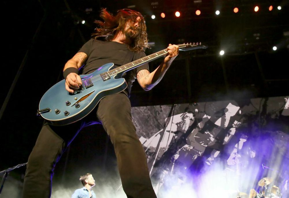 Dave Grohl Doing What He Does Best- Rockin' Out!  Photo Credit: Powers Imagery