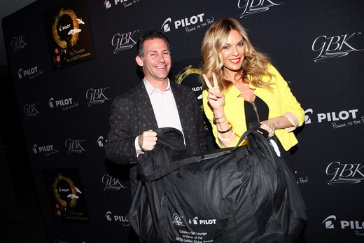 GBK CEO Gavin Keilly (L) and actress Jasmine Dustin attend the Pilot Pen and GBK Luxury Lounge honoring Golden Globe nominees and presenters held at the W Hollywood on January 9, 2015 in Hollywood, California. (Photo by Tommaso Boddi/Getty Images for GBK Productions)