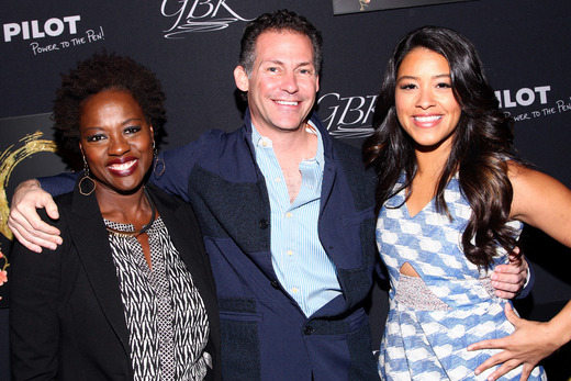 GBK CEO Gavin Keilly (C) poses with actresses Viola Davis and Golden Globe winner Gina Rodriguez at the Pilot Pen and GBK Luxury Lounge honoring Golden Globe nominees and presenters held at the W Hollywood on January 10, 2015 in Hollywood, California. (Photo by Tommaso Boddi/Getty Images for GBK Productions)