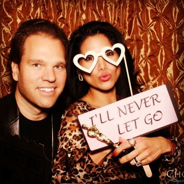 Joyce  Giraud and Michael Ohoven have fun in the photo booth at 'Salute To The Stars' Oscar Party! Courtesy Photo
