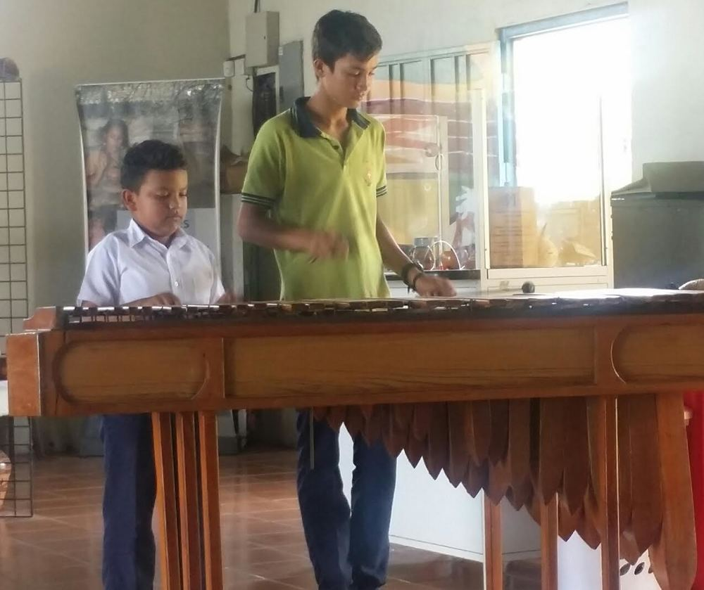 Locals Will Often Join Together to Play the Marimba.
