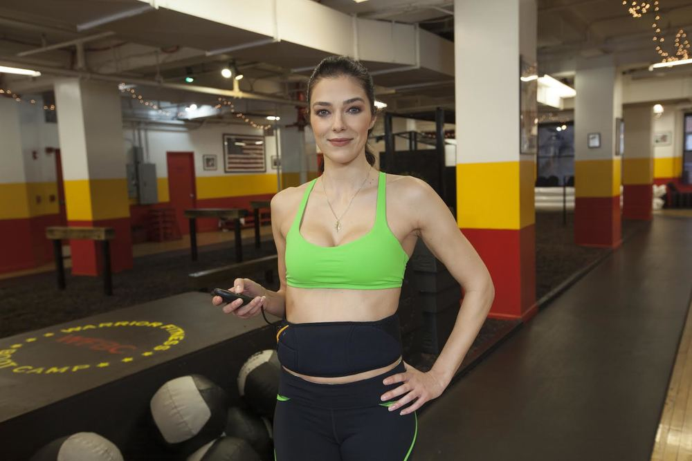 Adrianne Curry bringing in the New Year sexy and fit thanks to The Flex Belt! You can see how she uses The Flex Belt on the StarShop App starting January 4th! Courtesy Photo