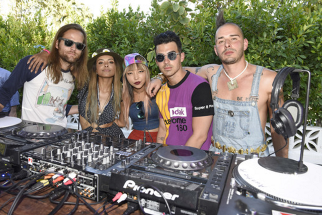 "DNCE and Kat Graham showed each other love during DNCE's exclusive DJ set at   The Music Lounge,   where the exclusive ""  WHAT HAPPENS HERE, STAYS HERE"" BEER (#WHHSH)   was launched     at the Ingleside Inn. (Photo Credit: Vivien Killilea/Getty Images for The BMF Media Group)."
