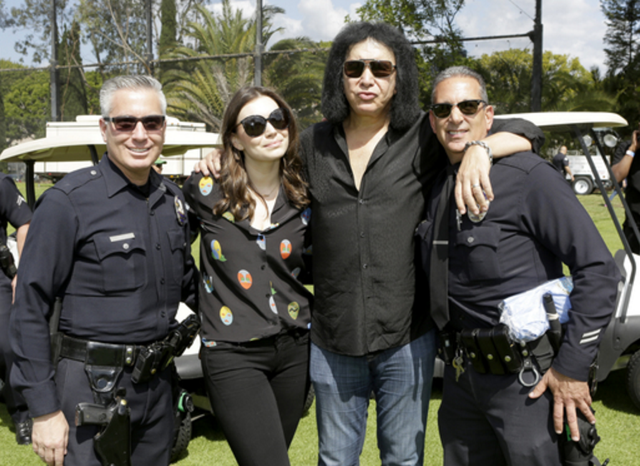 Rock legend Gene Simmons and his daughter Sophia posed for pictures with a few police officers at the 44th Annual Los Angeles Police Memorial Foundation Celebrity Golf Tournament at the Rancho Park Golf Course yesterday in Los Angeles. Proceeds from this event benefited family members of LAPD employees that have experienced catastrophic circumstances resulting from officer's injury or death. Since it's inception in 1972, the Foundation has granted more than $16 million for medical, funeral and educational expenses without any taxpayer money. Sponsors from the event included: Live Nation, Rubicon Resources, Kaiser Permanente, In-N-Out Burger and William Comfort Products. Photo Credit: Tiffany Rose/Getty Images