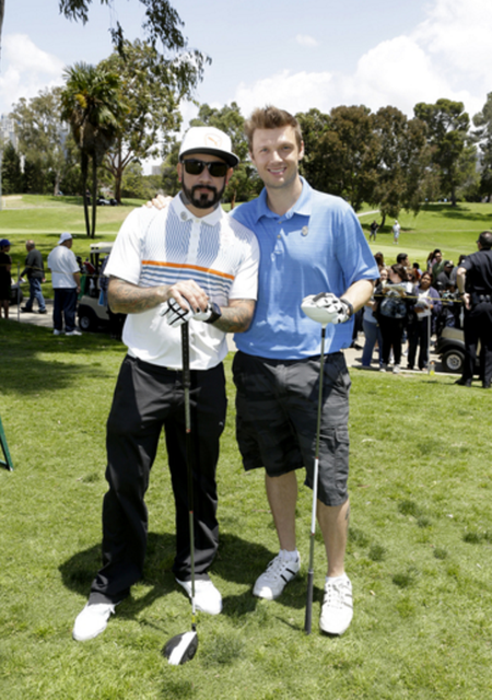 Former Backstreet Boys AJ McLean and Nick Carter showed each other some love (and played as a team!) at the 44th Annual Los Angeles Police Memorial Foundation Celebrity Golf Tournament at the Rancho Park Golf Course. Photo Credit: Tiffany Rose/Getty Images