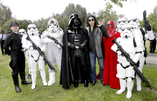 Rock legend Gene Simmons couldn't help but show his love for Darth Vader and some of the Star Wars Storm Troopers at the 44th Annual Los Angeles Police Memorial Foundation Celebrity Golf Tournament at the Rancho Park Golf Course. Photo Credit: Tiffany Rose/Getty Images