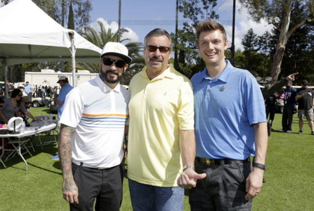 Backstreet Boy stars AJ McLean and Nick Carter were overjoyed to snap a few photos with LAPD Chief Charlie Beck at the 44th Annual Los Angeles Police Memorial Foundation Celebrity Golf Tournament at the Rancho Park Golf Course. Photo Credit: Tiffany Rose/Getty Images